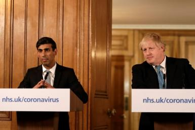 Prime Minister Boris Johnson's (R) finance minister Rishi Sunak (L) launched a budget package of stimulus measures worth £30 billion ($39 billion, 34.4 billion euros) to fight the growing threat from the coronavirus epidemic to the economy