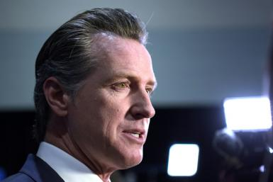 California Governor Gavin Newsom, pictured in December 2019, said California's measure will likely not be enforced by police