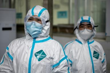 Medical workers wearing hazmat suits as prevention against the COVID-19 coronavirus at work at the Huanggang Zhongxin Hospital in Huanggang, in China's central Hubei province
