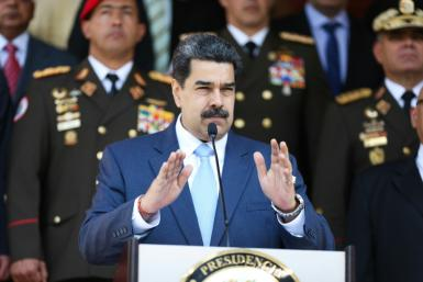 "Venezuela's President Nicolas Maduro, in a handout picture released by Venezuela's presidential palace, has been indicted by the United States on ""narco-terrorism"" charges"