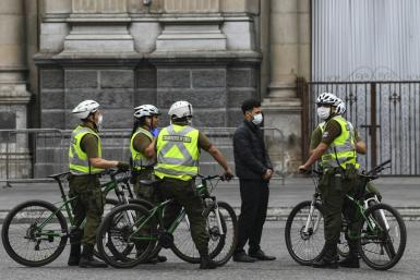 Chilean soldiers carry out a check in Santiago, where people in seven of the city's main communes will enter into total quarantine for a week starting Thursday night