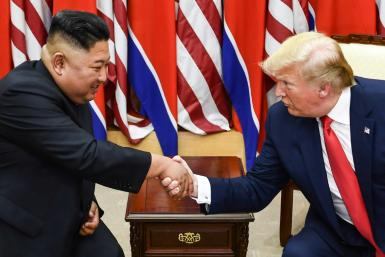 North Korean leader Kim Jong Un (L) and US President Donald Trump shake hands on June 30, 2019, during a meeting on the south side of the Military Demarcation Line that divides North and South Korea