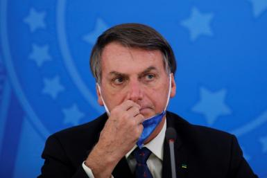 "Brazil's President Jair Bolsonaro insists the coronavirus is just a ""little flu"" and opposed the self-isolation measures now observed by half the wold's population"