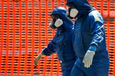Russian army specialists outside a nursing home in the Lombardy region, the epicentre of the coronavirus outbreak in Italy