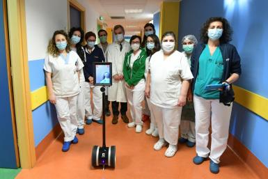 Medical staff in Varese, northern Italy, with Ivo the robot who helps them treat seriously ill coronavirus patients and reduce the risk of them getting infected