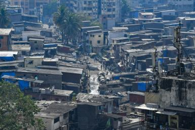 Social distancing is near impossible for the roughly one million people in the Dharavi slum in Mumbai