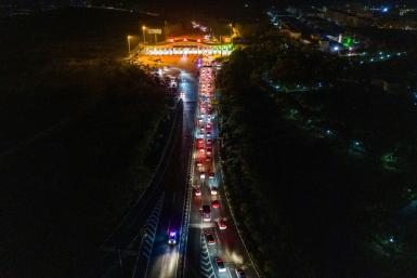 There was a steady stream of cars headed out of Wuhan as travel restrictions were eased