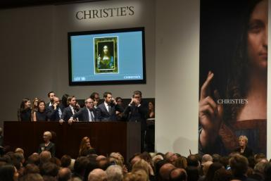 """Experts don't believe in-person auctions for major works of art like Leonardo da Vinci's """"Salvator Mundi"""" are at risk, but the coronavirus crisis is likely to push the industry even further to online business"""