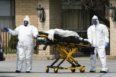 Medical personnel transport a body at the Andover Subacute and Rehabilitation Center in New Jersey on April 16, 2020
