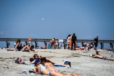 Beachgoers in the US state of Georgia flocked to the shore after the government lifted lockdown orders