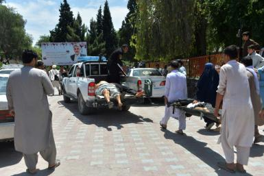 Injured mourners are taken to hospital after a suicide bomb attack on a funeral in eastern Afghanistan