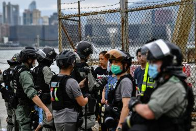 Pro-democracy protesters and police clashed in Hong Kong after a controversial security law proposal by China sparked outrage