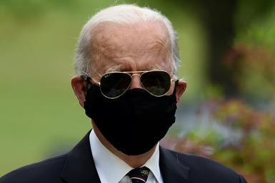 Democratic presidential candidate Joe Biden wears a black face mask during his first public appearance in more than two months