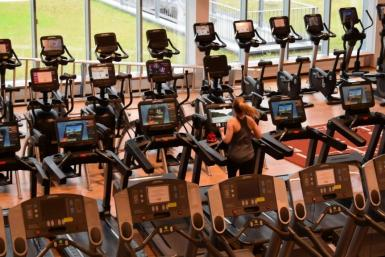 Members return to World Class Laugar, one of Iceland's biggest gyms, after the goverment lifted more coronavirus restrictions on Monday
