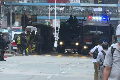 Police fire tear gas and water cannon at thousands of Hong Kong pro-democracy protesters who gather against a controversial security law proposed by China, in the most intense clashes in months.