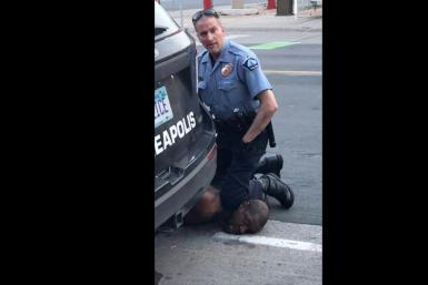 A Minneapolis police officer holds his knee to the neck of George Floyd, who died in police custody.