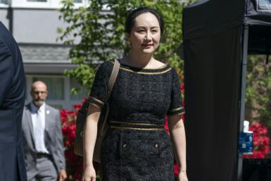 Meng Wanzhou, CFO of Huawei, walks down her driveway to her car as she departs her home for court on May 27, 2020 in Vancouver, Canada