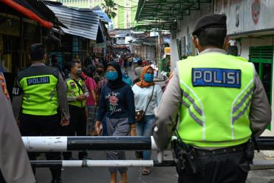 Alongside police and troops overseeing enforcement measures, provincial leaders are running their own zealous campaigns to fight the virus in Indonesia