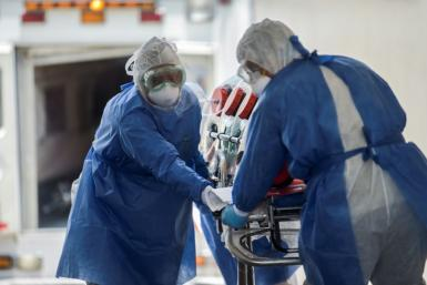 Mexican Red Cross' paramedics rush a patient suspected of being infected with the novel COVID-19 coronavirus into Venados General Hospital, in Mexico City