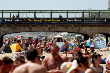 Britons revelled in soaring temperatures by flocking to beaches and parks ahead of a further easing of lockdown measures
