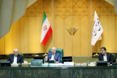 Iranian Parliament speaker Mohammad-Bagher Ghalibaf (C) chairing a parliament session in the capital Tehran