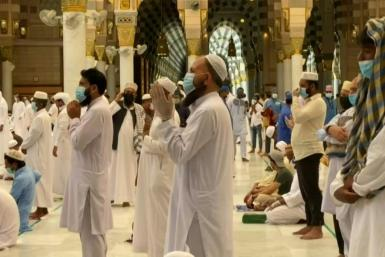 Worshippers pray at the Prophet's Mosque in the holy city of Medina after Saudi authorities allowed it to reopen at 40 percent capacity
