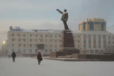 Locals walk through a square in the Siberian city of Yakutsk, where a court ruled to commit a shaman critical of Vladimir Putin to a mental asylum