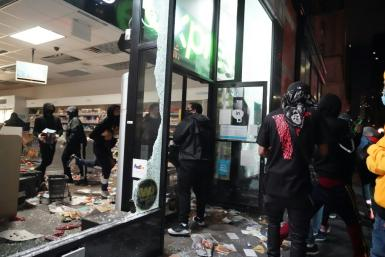 Looters hit stores in New York where the mayor has imposed an overnight curfew