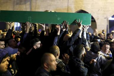 Thousands of mourners attended the funeral of Iyad Hallak