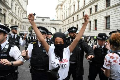 Protestors remonstrate with police officers during an anti-racism demonstration in London after George Floyd, an unarmed black man, died after a police officer knelt on his neck during an arrest in Minneapolis, USA.