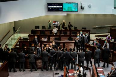 Pro-democracy lawmakers shouted slogans during the anthem debate