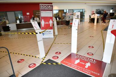 Social distancing markers are displayed inside the recently re-opened Vauxhall car dealership as post-lockdown business takes off
