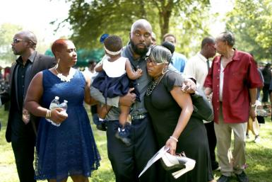 The father of Michael Brown, attending the funeral of his son who was killed by a police officer