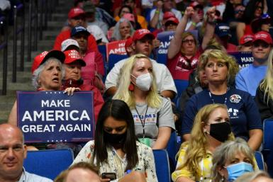 Supporters of US President Donald Trump listen to him speak at his Tulsa campaign rally