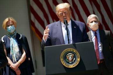 US President Donald Trump is seen flanked by top White House coronavirus task force officials Deborah Birx (L) and Anthony Fauci (R), on May 15, 2020