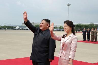 Anti-North Korea leaflets launched from the South included 'dirty, insulting' depictions of leader Kim Jong Un's spouse, Ri Sol Ju (R), Russia's ambassador said