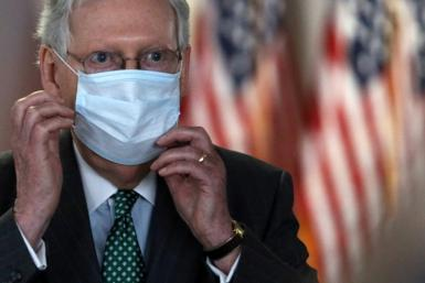 U.S. Senate Majority Leader Mitch McConnell is among the prominent Republicans to don masks as the US coronavirus outbreak worsens