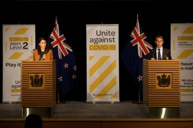 Prime Minister Jacinda Ardern (L) said the minister's presence had become a distraction. He had also been accused of blaming top health official Ashley Bloomfield (R)