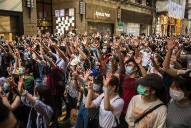 Hong Kong protesters rally against a sweeping new national security law that has prompted some Western nations to offer those from the city refuge