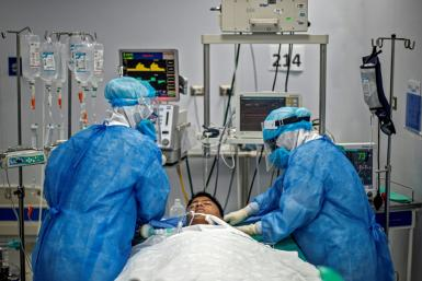 Nurses check the intubation of a COVID-19 patient in Lima, Peru, which has topped 10,000 deaths