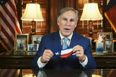 Texas Governor Greg Abbott, a Republican and ally of US President Donald Trump, issues an executive order requiring face coverings in public spaces as the state marks record numbers of new infections.