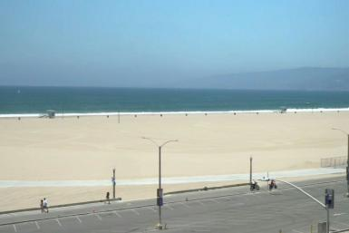 While some people are seen walking around 3rd Street Promenade, Santa Monica State Beach and the Pier lie empty on the July 4th holiday amid growing concerns over the spread of the coronavirus in California