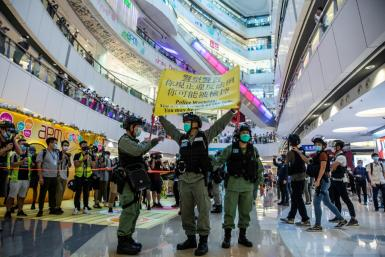 Certain political views, slogans and signs became illegal in Hong Kong overnight with the passage of China's new national security law for the city