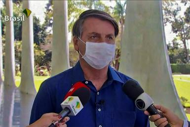 "Brazilian President Jair Bolsonaro said he was feeling ""perfectly well"" after testing positive for COVID-19"