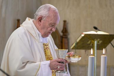 This photo taken and handout on July 8, 2020 by the Vatican Media shows Pope Francis celebrating the Eucharist during a mass at the Santa Marta chapel in The Vatican, marking the 7th anniversary of his visit to Lampedusa on July 8, 2013.
