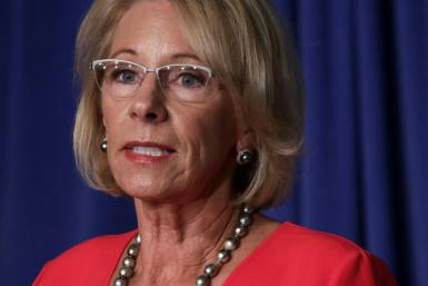 Education Secretary Betsy DeVos, seen in a July 8, 2020 White House briefing, has insisted that schools across the country must aim for full reopenings in the fall, saying they otherwise risk losing federal funds