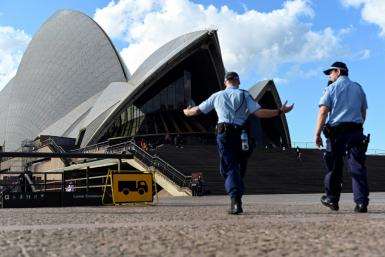 Police patrol near the Sydney Opera House, an area usually thronged with tourists, during Australia's coronavirus outbreak