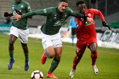 Saint-Etienne's French forward William Saliba (L) vies with Dijon's French-Togolese defender Arnold Bouka Moutou (R)