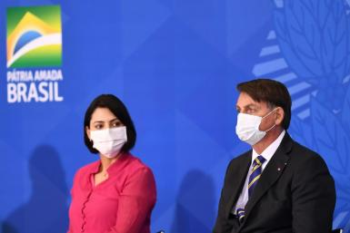 Brazilian President Jair Bolsonaro and the first lady Michelle Bolsonaro attend the launch of the Rural Women's Rights program at Planalto Palace in Brasilia, on July 29, 2020