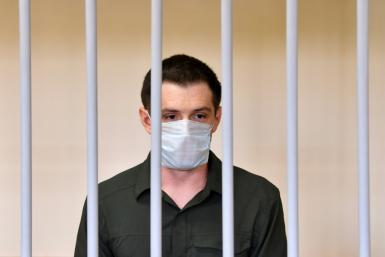 US ex-marine Trevor Reed appeared in a cage for defendants in a courtroom in the Russian capital as the judge read out the guilty verdict